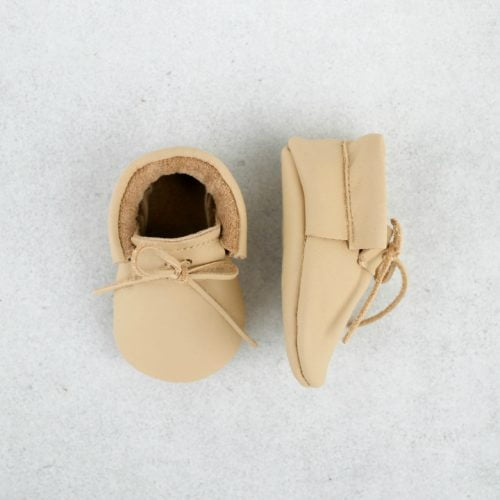 laced sand moccasins over