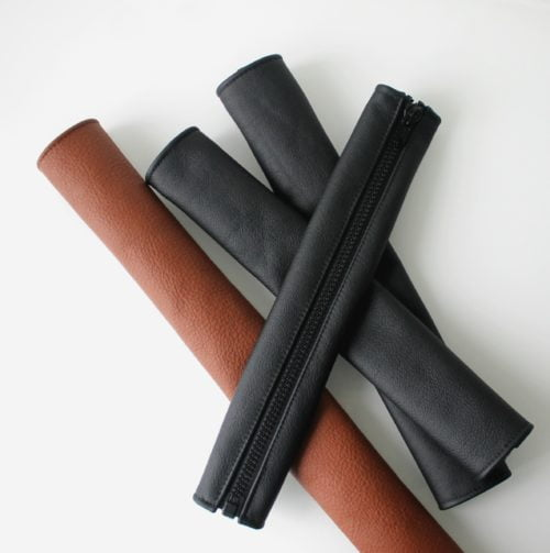 Leather handle covers in a pile