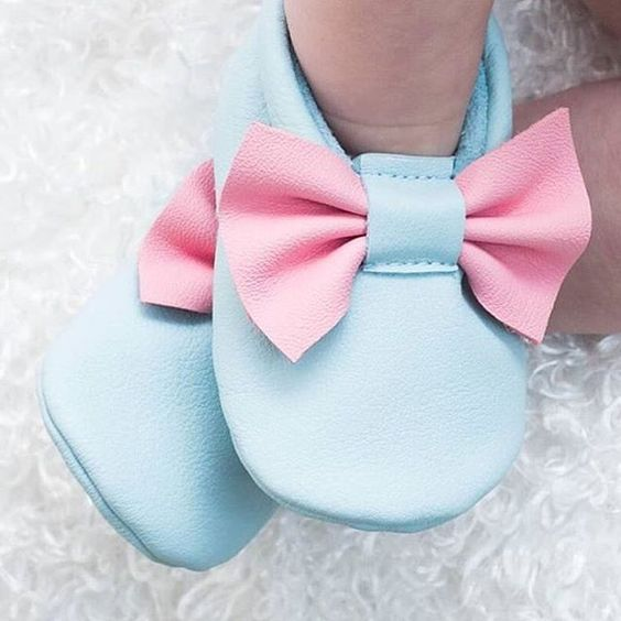 Cotton Candy moccasins on baby feet